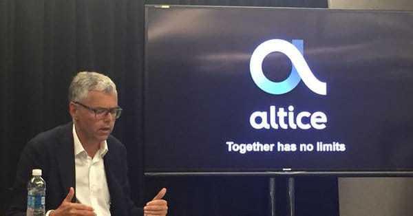 Michel Combes et logo Altice